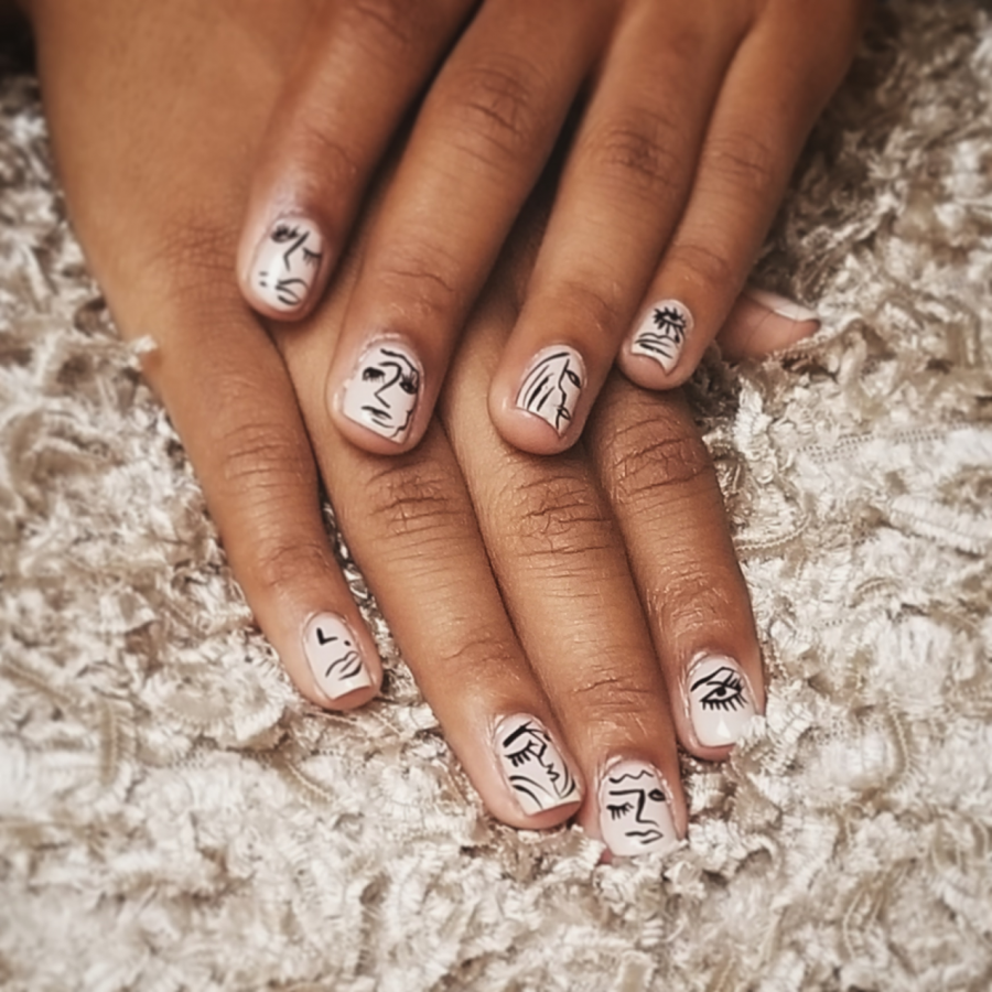Glam+and+Glitz+-+Jada+Morris+poses+with+newly+done+nails+at+LUXX+Nails+and+Beauty+Salon+located+in+Neptune+City.+Her+nails+have+an+intricate+design+of+abstract+faces.