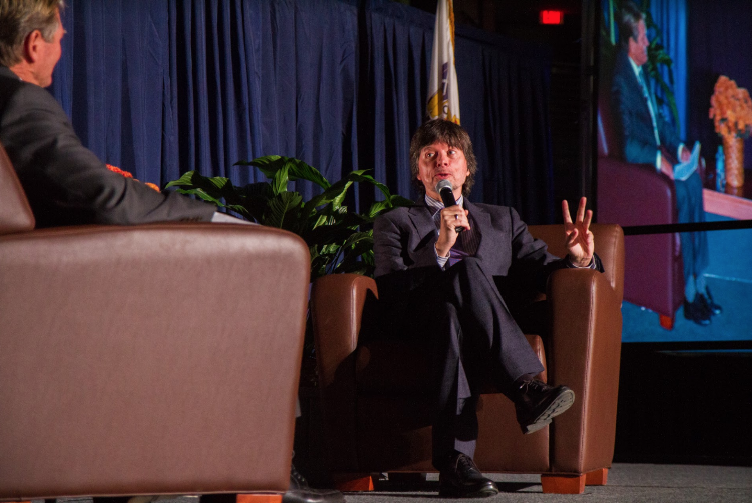 Documentary Filmmaker Ken Burns responds to questions from History Professor Jess Levine on Oct. 27 at the Collins Arena